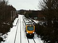 Train leaving Bramley in the snow (geograph 6731381).jpg