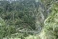 Trekkers crossing a suspension bridge on the Nenggao Historic Trail.jpg