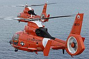 Two coast guard HH-65C Dolphin helicopters