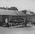 Two men pictured with rowboats in a yard - Dun Laoghaire (22215004250).jpg
