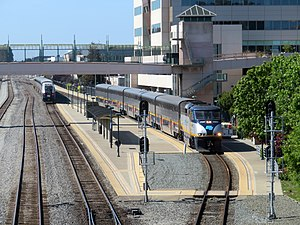 Two trains at Emeryville station, June 2018.JPG