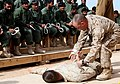 U.S. Marine Corps Sgt. Shane Willis, Police Advisor Team chief instructor, 2nd Battalion, 6th Marine Regiment, teaches a class on handcuffing procedures to Afghan Local Police (ALP) recruits during an ALP 120208-M-MA864-769.jpg