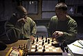 U.S. Marine Sgt. Jeremy Scott (left), and Lance Cpl. Tyler Dickinson, a squad leader and assaultman with 3rd Platoon, Kilo Company, 3rd Battalion, 3rd Marine Regiment, play a game of chess after a day of work at 120226-M-MM918-007.jpg