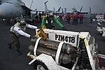 U.S. Marines assigned to Marine Strike Fighter Squadron (VMFA) 323 move a nitrogen cart on the flight deck of the aircraft carrier USS Nimitz (CVN 68) in the Indian Ocean June 7, 2013 130607-N-LP801-076.jpg