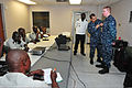 U.S. Navy Hospital Corpsman 1st Class Jose Vargas, second from right, demonstrates first aid for a sucking chest wound to Congolese service members during a medical training event aboard high speed vessel Swift 120516-F-VZ366-051.jpg
