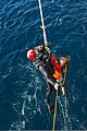 U.S. Navy Seaman Ian Soper participates in a search and rescue drill during a simulated man overboard drill with the guided missile destroyer USS Truxtun (DDG 103) Dec. 6, 2013, in the Atlantic Ocean 131206-N-EI510-092.jpg