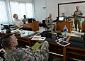 U.S. Soldiers with the U.S. Army Pacific Contingency Command Post and Daniel Dieckhaus, second from left, a humanitarian assistance advisor with the U.S. Agency for International Development, hold a daily after 130604-A-XN199-003.jpg