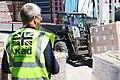 UK aid staff manage vital aid being loaded onboard HMS Ocean (36373697353).jpg