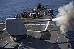 USS Carney conducts a live-fire exercise. (23459530479).jpg
