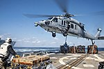 USS Chung-Hoon takes on supplies during a vertical replenishment-at-sea (25159358313).jpg