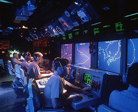 Sitting in the combat information center aboard a warship - proposed as a real-life analog to the Chinese Room USS Vincennes (CG-49) Aegis large screen displays.jpg