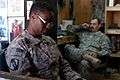 US Army 52572 Spc. Talaya R. Mitchell (left), a maintenance administrator from Grenada, Miss., reviews a vehicle parts request while Sgt. 1st Class Perrin E. Dickerson, a motor sergeant from Senatobia, Miss., takes.jpg