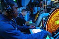 US Navy 020923-N-8590G-001 Air Traffic Controller 2nd Class John J. Jones monitors the AN-SPN-43 Precision Approach Radar from the helicopter direction center, during flight operations off the coast of Okinawa, Japan.jpg
