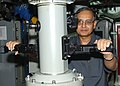 US Navy 030823-N-3349L-002 The Indian Ambassador to Bahrain, Bhaskar Kumar Mitra, looks through a periscope aboard attack submarine USS Memphis (SSN 691).jpg