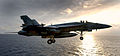 US Navy 031115-N-6213R-270 An F-A-18E Super Hornet assigned to the Eagles of Strike Fighter Squadron One One Five (VFA-115) flies into the late afternoon sky after launching from USS John C. Stennis (CVN 74).jpg