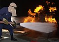 US Navy 040708-N-8977L-009 A nozzelman leads a hose team while extinguishing Class Bravo fire at Fleet Training Center (FTC) San Diego, Calif.jpg
