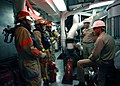 US Navy 040910-N-1693W-059 Sailors assigned to Repair Locker Three hose team aboard amphibious command ship USS Blue Ridge (LCC 19), listen for instructions from the Damage Control Training Team.jpg