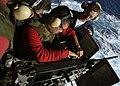 US Navy 041207-N-5837R-090 Sailors aboard the Nimitz-class aircraft carrier USS Abraham Lincoln (CVN 72) reload a M2 .50 caliber machine gun before firing 200 rounds.jpg