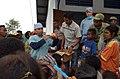 US Navy 050328-N-6665R-199 Dental Technician 1st Class Francis Andaye demonstrates proper dental hygiene after distributing preventative dental kits to Indonesian patients.jpg