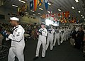 US Navy 050703-N-5373B-043 Several Sailors serve as flag bearers marching through the hangar bay to honor the Iwo Jima Veterans of Portland during a ceremony.jpg
