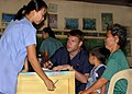 US Navy 050819-N-7415V-002 Josephine Aglibot, a midwife with the Philippine Navy, explains a patient's situation to U.S. Navy Lt. Erik Modlo.jpg