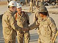 US Navy 060103-N-3750S-041 Chief of Naval Operations, Adm. Mike Mullen, left, greets Construction Mechanic 3rd Class Rolando Sobrepena, while Naval Mobile Construction Battalion Two Two (NMCB-22) Commanding Officer, Capt. Steve.jpg