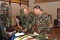 US Navy 060614-N-6996K-004 Commander, Navy Expeditionary Combat Command (NECC), Rear Adm. Donald K. Bullard is briefed by Senior Chief Boatswain Mate Robert McCue Jr.jpg