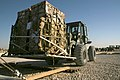 US Navy 061219-N-3067W-077 Electronics Technician 3rd Class Daniel Yepez, assigned to Navy Cargo Handling Battalion One (NCHB-1) Cargo Transfer Platoon, drives a 10K forklift to transfer a pallet of cargo to a staging area.jpg