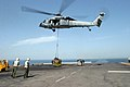 US Navy 070509-M-9389C-005 An MH-60S Seahawk, from Helicopter Sea Combat Squadron (HS) 28, delivers supplies to the amphibious assault ship USS Bataan (LHD 5) during a replenishment at sea (RAS).jpg