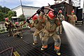US Navy 070606-N-3390M-001 A group of 16 Sailors assigned to the Arleigh Burke class guided missile destroyer USS Shoup (DDG 86) get hands on firefighting training at Fremont Maritime Services in Seattle Washington.jpg