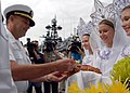 US Navy 070701-N-5621B-333 Submarine tender USS Frank Cable (AS 40) Commanding Officer, Capt. Leo Goff participates in a welcoming ceremony on the pier.jpg
