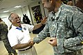 US Navy 070717-F-0193C-005 Medal of Honor recipient, retired Marine colonel, and deputy Assistant Secretary of the Navy Barney Barnum thanks a U.S. Army Soldier attached to the 1st Cavalry Division for his service at Camp Liber.jpg