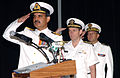 US Navy 070801-N-7095C-001 Pakistani Commodore Khan Hasham Bin Siddique, Vice Adm. Kevin Cosgriff and French Rear Admiral Alain Hinden salute their flags during the Combined Task Force (CTF) 150 change of command ceremony.jpg