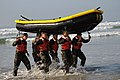 US Navy 080116-N-6730G-006 Basic Underwater Demolition-SEAL students work together during small boat training known as surf passage training.jpg