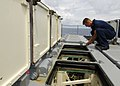 US Navy 080724-N-4236E-120 Gunner's Mate 1st Class Robert Lambert performs maintenance on the missile deck.jpg