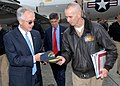 US Navy 080729-N-9860Y-005 Capt. Ken Seliga presents Deputy Secretary of Defense, the Honorable Gordon England, with a command ball cap.jpg