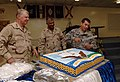 US Navy 080816-N-8273J-320 Culinary Specialist 3rd Class Adam Leduc cuts a cake in honor of Chief of Naval Operations (CNO) Adm. Gary Roughead, left, and Master Chief Petty Officer of the Navy (MCPON) Joe R. Campa Jr.jpg