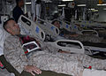 US Navy 081009-N-6410J-033 Marines lie wounded in the intensive care unit aboard USS Boxer (LHD 4).jpg
