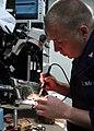 US Navy 081202-N-6764G-093 Electronics Technician 3rd Class Scott Clark repairs a circuit board.jpg