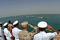 US Navy 090430-N-8053S-190 Dignitaries render a salute to a pass and review of Iraqi and U.S. Navy ships during a ceremony to turn over control of the Khawr Al Amaya Oil Terminal off the coast of Basra in the Persian Gulf from.jpg
