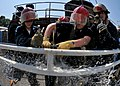US Navy 090611-N-1745W-013 Sailors of the USS Abraham Lincoln (CVN 72) patch a bursting water pipe during a wet trainer simulation held by Fremont Maritime Services.jpg