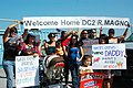 US Navy 090909-N-0209M-003 Family members and friends wave signs and cheer as the mine countermeasures ship USS Sentry (MCM 3) arrives at its new homeport at Naval Base San Diego.jpg