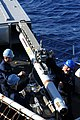 US Navy 091017-N-0890S-010 Sailors load a RIM-7M Sea Sparrow surface-to-air missile into a launcher aboard the multi-purpose amphibious assault ship USS Wasp (LHD 1).jpg