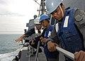 US Navy 091206-N-9520G-054 Ensign Robert A. Thomas shows Chief Petty Officer Abdul Malek Bin Amat Salleh and Petty Officer M. Satar Muhamad procedures of receiving fuel.jpg