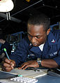 US Navy 100127-N-1082Z-019 Quartermaster 3rd Class Davonne Lewis, from Lincolnton, N.C., plots a course from the bridge of the amphibious dock landing ship USS Ashland (LSD 48).jpg