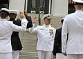 US Navy 100430-N-8273J-104 Adm. Gary Roughead administers the oath of office to 10 newly commissioned Navy and Marine Corps officers during the Naval Reserve Officers Training Corps commissioning ceremony at Florida A^M Univers.jpg