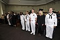 US Navy 100604-N-8335D-027 Students and guests stand during the playing of the national anthem at a Navy College graduation celebration in the main base chapel at Fleet Activities Sasebo.jpg