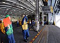US Navy 100909-N-1004S-039 Sailor signal the fast combat support ship USNS Bridge (T-AOE 10) from the aircraft carrier USS Ronald Reagan (CVN 76).jpg