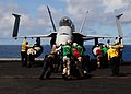 US Navy 100911-N-3327M-085 Sailors assigned to the Sidewinders of Strike Fighter Squadron (VFA) 86 push an F-A-18C Hornet.jpg