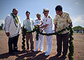 US Navy 101005-N-0995C-032 Capt. John Coronado, along with Capt. Rick Kitchens, untie the Maile Lei at the Ford Island Child Development Center gr.jpg